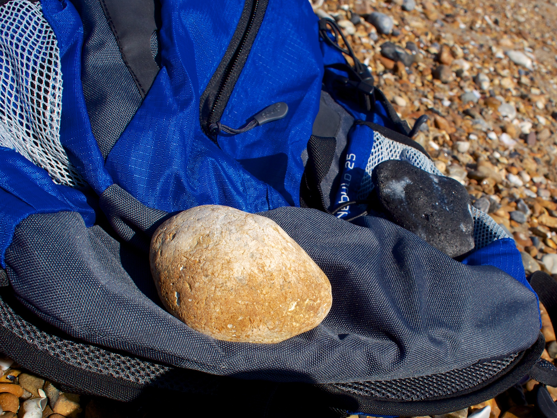 My all-purpose rucksack being used as a stone holder